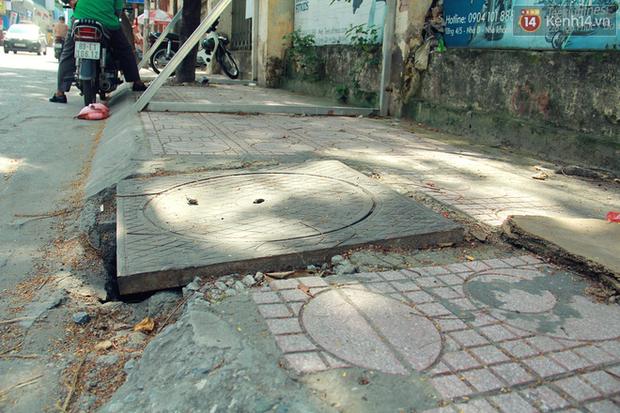 Hà Nội: Người dân vô tư ngồi bán hàng, trú nắng dưới bức tường rào sắp đổ sập của nhà khách La Thành - Ảnh 17.