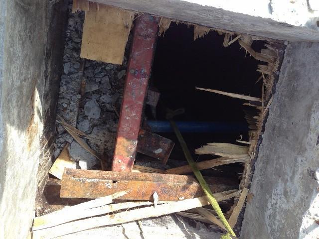 Phát hiện 2 công nhân tử vong, 1 người nguy kịch dưới tầng hầm khách sạn - Ảnh 1.