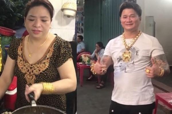 Kỳ lạ cặp vợ chồng bán hàng vỉa hè đeo cả cân vàng trên người - Ảnh 1.