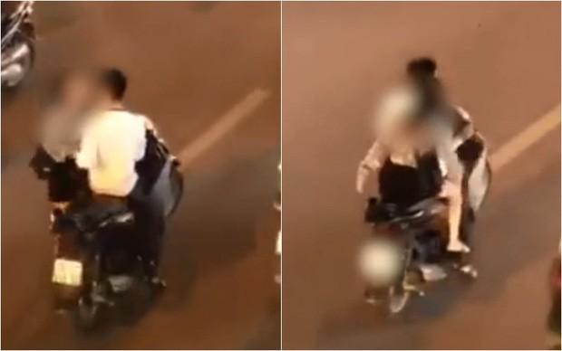 Đôi nam nữ gây bức xúc khi không đội mũ bảo hiểm, dừng xe máy giữa đường phố để... cãi nhau - Ảnh 1.