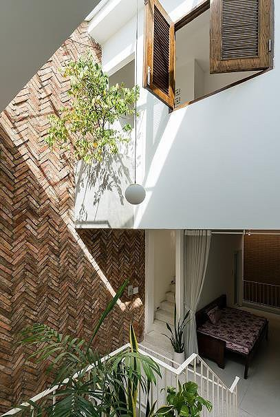 Ngôi nhà nằm sâu trong hẻm ở Sài Gòn đẹp ngỡ ngàng - Ảnh 7.