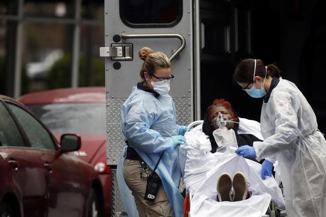 Nước Pháp sốc vì mất thêm hơn 1.300 người trong 1 ngày, Mỹ thêm gần 3 vạn ca mắc mới COVID-19 - Ảnh 3.
