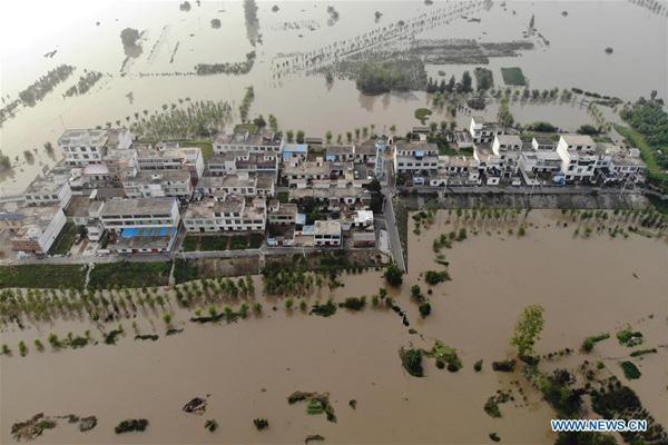 Hình ảnh lũ lụt tồi tệ tại Trung Quốc: Di sản bị nhấn chìm, đập lớn nhất thế giới đứng trước nguy cơ vượt giới hạn - Ảnh 5.