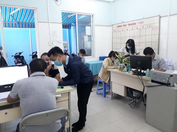 TPHCM: Hơn 14.000 người được lấy mẫu xét nghiệm - Ảnh 2.