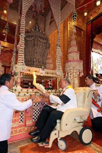 This handout photograph taken and released by the Royal Bureau on April 9, 2012 shows Thai King Bhumibol Adulyadej (r) preside at the royal cremation of Thai Princess Bejaratana Rajasuda Sirisobhabannavadi at Sanam Luang in Bangkok.