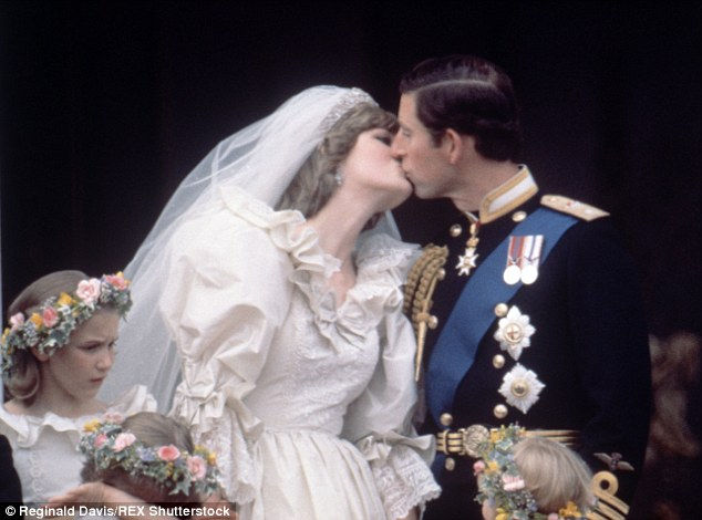 And then he kissed her: Prince Charles and Princess Diane give the cheering crowds on the Mall - and the worlds media - what they want... a Buckingham Palace balcony embrace after their wedding ceremony at St Pauls Cathedral yesterday