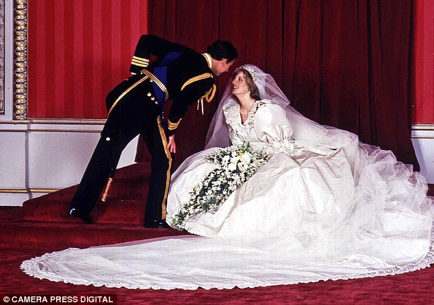 Dress of dreams: Prince Charles manages to avoid the 25ft train as he asks for a kiss from his bride