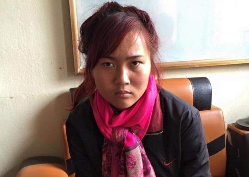 Đối tượng Nguyễn Thị Dung tại cơ quan điều tra. Ảnh Công an cung cấp