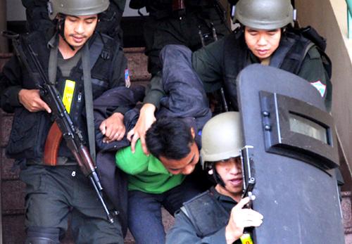Cảnh sát cơ động sẽ chuyên về phòng chống tội phạm chứ không can thiệp vào các xử lý vi phạm hành chính. Ảnh: Quốc Thắng.