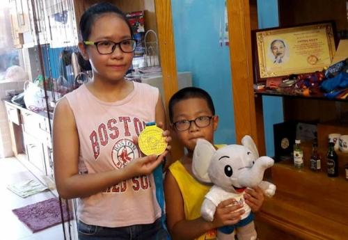 Con gái và con trai của xạ thủ vàng Hoàng Xuân Vinh
