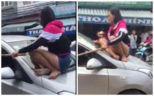 Người vợ nhảy lên nóc xe yêu cầu chồng và cô bồ bước ra ngoài.