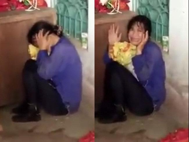 Hình ảnh người phụ nữ sợ hãi khi người dân phát hiện. Ảnh cắt từ clip