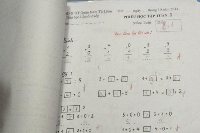 Bài tập Toán của con gái chị Hương vào chiều 17/10 vẫn được giáo viên chấm điểm dù Bộ GD&ĐT đã có quy định bỏ việc chấm điểm ở bậc tiểu học. Ảnh: N.Hạnh