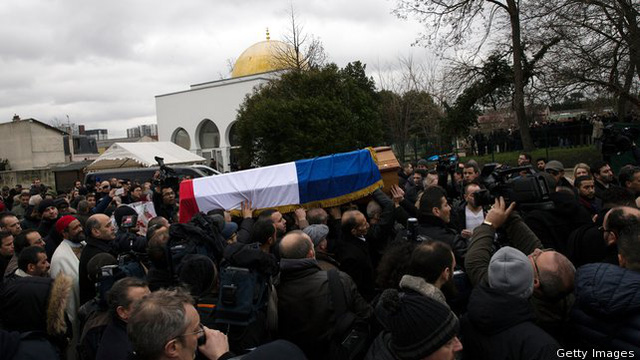 The funeral of murdered police officer Ahmed Merabet takes place at a muslim cemetery in Bobigny