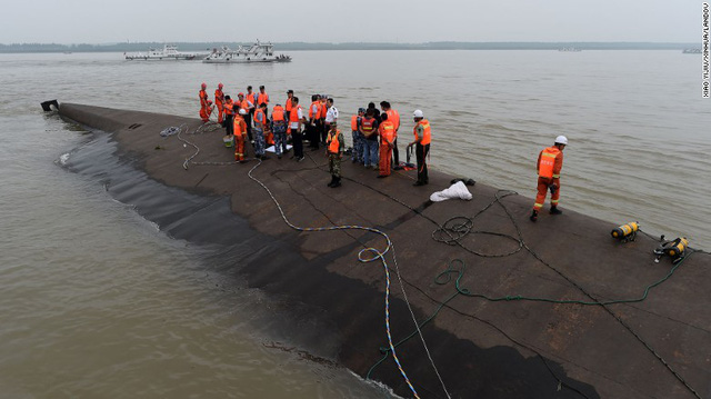 Rescuers work at the site of an overturned passenger ship on Chinas Yangtze River on Tuesday, June 2. The Eastern Star capsized late Monday in stormy weather as it carried 458 passengers and crew.