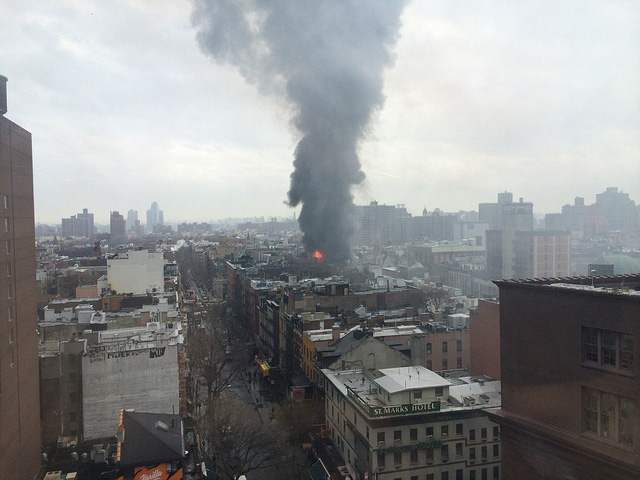 Horror: Looking towards the fire from Astor Place, flames can be seen reaching into the sky from the building