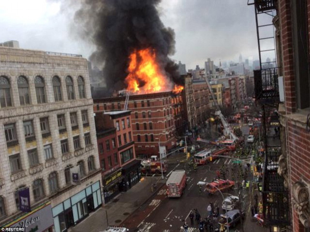 Blast: Fire ravages a building on Second Avenue in the East Village of New York following the smell of gas on Thursday