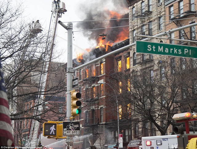 Terror: Flames can be seen coming out of two buildings on Second Avenue between 7th Street and St Marks Place