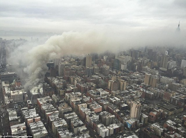 The thick smoke reached across the citys blocks and towards the Empire State Building (right) throughout the afternoon