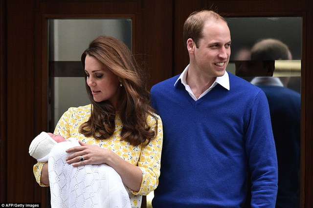 Kate, a mother for the second time in two years, looks lovingly at her new bundle of joy while Prince William puts a protective arm around her