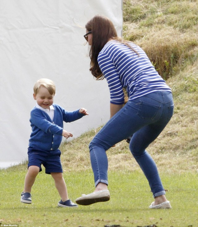 Kate is full of energy jumping from side to side, as she plays with a laughing George, who is no doubt trying to evade her