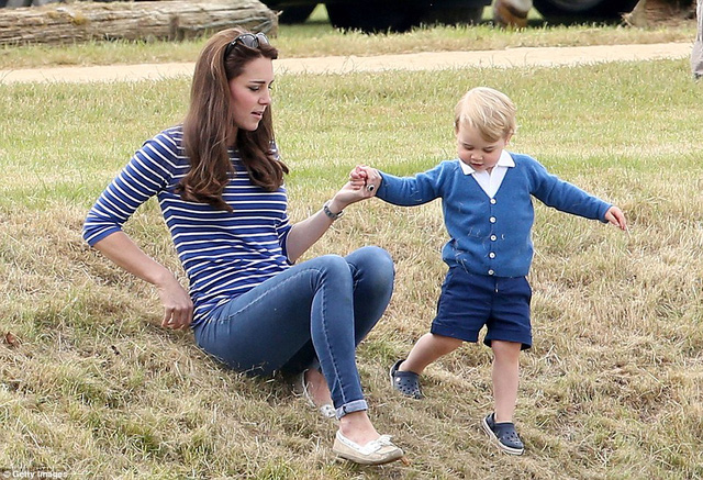 Whos leading who? Prince George gallantly takes his mothers hand as he attempts to walk down a grass verge with Kate