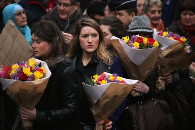Mourners pay their respects to Charlie Hebdo cartoonist Bernard (Tignous) Verlhac.