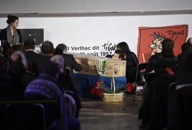 People write on the coffin of Bernard (Tignous) Verlhac.