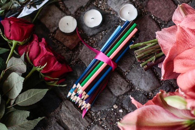 Colored pencils, flowers and candles in front of the French Embassy in Berlin commemorate the victims killed in yesterdays attack at the Paris offices of the weekly newspaper Charlie Hebdo.