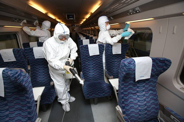 Workers disinfecting a train in Seoul on June 7; South Korea has confirmed 23 more cases of the MERS virus, which has killed six people in the country.