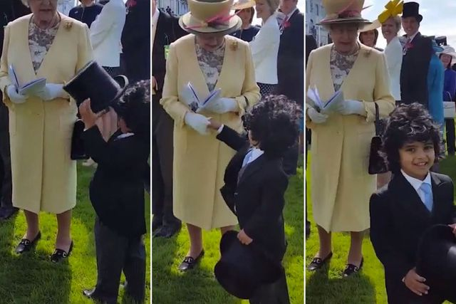 Boy takes off his top hat and shakes the Queens hand