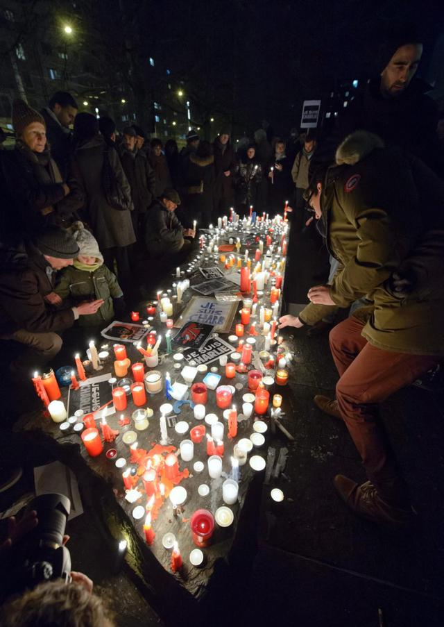 People gather for a rally in Geneva, Switzerland, in solidarity with the journalists murdered and injured yesterday at the offices of Charlie Hebdo magazine. Masked gunmen with automatic rifles killed 12 people at the Paris headquarters of the weekly.