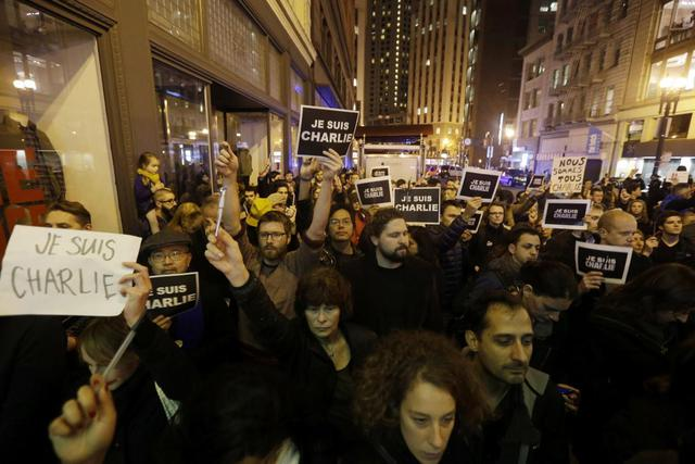 A crowd holds signs reading I am Charlie in French during a rally outside the French Consulate in San Francisco following a deadly terror attack at the Paris offices of the weekly newspaper Charlie Hebdo. Some participants in the Wednesday night vigil in