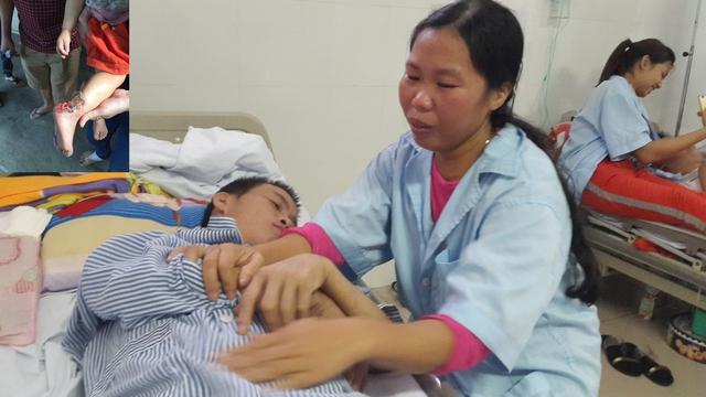 Chị Hằng khóc nghẹn khi biết chồng mình có thể bị liệt. Chân đứa con út của anh Mỳ bị hoại tử (ảnh nhỏ). Ảnh: T.G