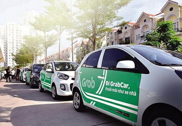 Uber, Grab bị kiến nghị làm ảnh hưởng đến đề án phát triển giao thông công cộng. ảnh: TL