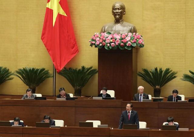 Bộ trưởng Bộ Thông tin và Truyền thông Trương Minh Tuấn trả lời chất vấn tại Quốc hội. Ảnh:TL