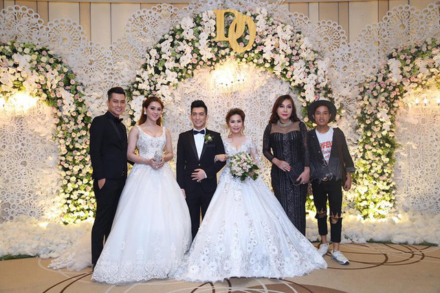 Vợ chồng Bảo Duy chụp ảnh với quan khách trong tiệc cưới 2 tỷ ở khách sạn 5 sao.