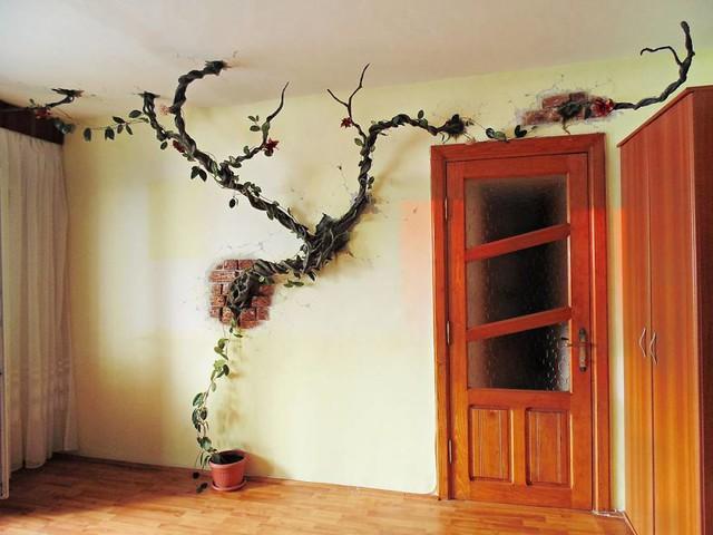 Nghệ sĩ này đã tạo nên những bức tường giống như những cành cây đang nứt tường ra để vươn trồi và nảy lộc.