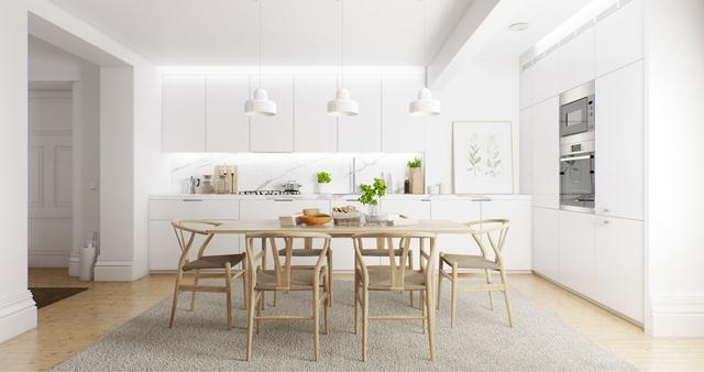 2. Căn phòng toàn màu trắng từ tường đến tủ kệ trở nên nổi bật với bộ bàn ghế làm bằng gỗ thiết kế mộc mạc. Vật liệu gỗ cũng trở thành điểm nhấn cho chậu cảnh, khung tranh, đồ dùng nhà bếp,…