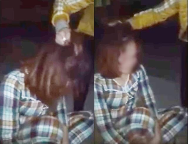 Người phụ nữ bị túm tóc chửi bới khi bị bắt quả tang ngủ với chồng của chị em kết nghĩa ngay tại nhà. Ảnh cắt từ clip