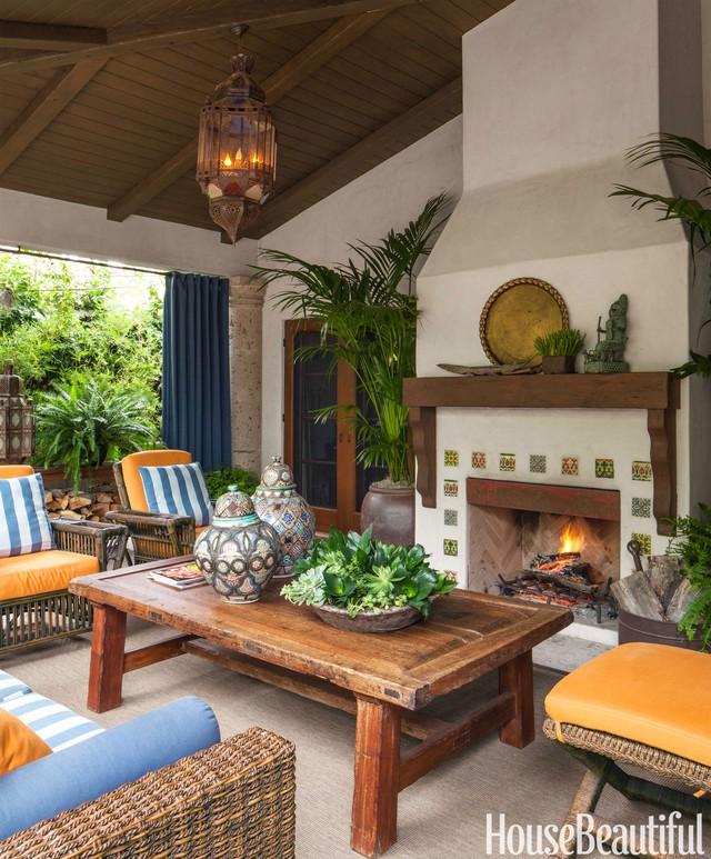 14. Phong cách rustic với những món đồ gỗ và mây đơn giản nhưng ấm cúng lại đậm chất nhiệt đới của góc thư giãn hoàn hảo này sẽ giúp những ngày thu càng trở nên lãng mạn.