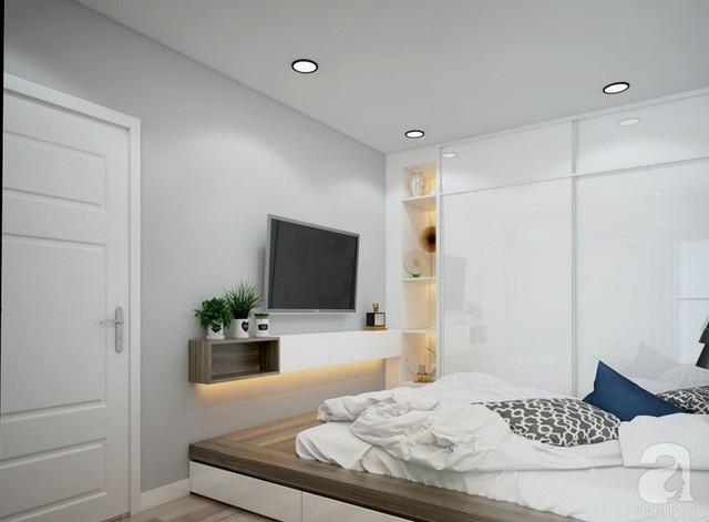 Phòng ngủ của bố mẹ được chọn lựa màu trắng làm gam màu nền, chiếc giường và một phần tường cạnh giường làm điểm nhấn cho không gian nghỉ ngơi của vợ chồng chị Trang.