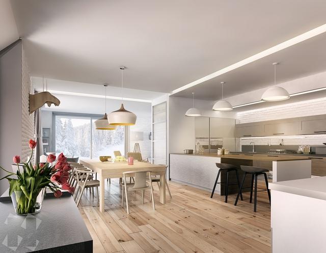 16. Sắc trắng trong căn phòng này tuy không chiếm ưu thế nhưng nó đã được xen kẽ với gam màu xám bạc sang trọng. Bàn ghế gỗ và sàn nhà như tạo nên sự kết nối, dẫn dắt các thành viên tiến đến phía bàn ăn.