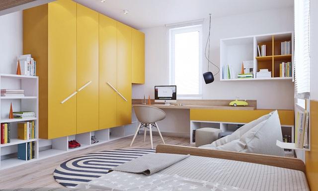Góc giường ngủ được bố trí sát tường với hệ thống tủ đựng đồ và kệ liên kết màu sắc với nhau.