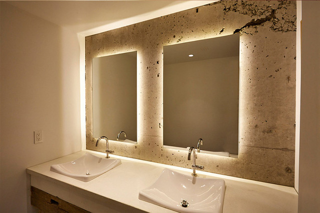 5. Besides making the room feel bigger, the use of the light behind the mirror also creates the dimension after you look in.