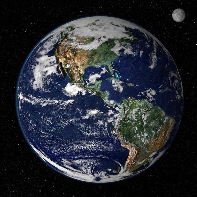 Từ không gian, Trái đất chỉ là một quả cầu với những mảng màu sắc.