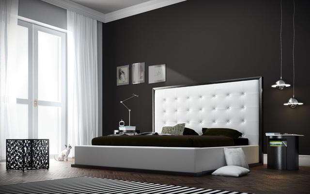 Phòng ngủ trung lập này biến chiếc giường trắng thành một điểm trung gian rõ ràng có thể che khuất các yếu tố khác trong phòng nếu không có tấm thảm sọc đen trắng là điểm nhấn.