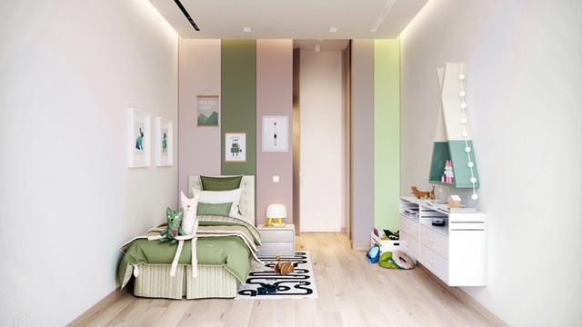 Không gian được bố trí đơn giản nhưng không hề đơn điệu. Giường đơn được đặt sát tường là nơi để bé được nghỉ ngơi. Màu xanh dịu dàng của chăn nệm và kệ trang trí, tranh treo tường là màu nhấn mang đến sự bình yên, ngọt ngào cho căn phòng của bé.