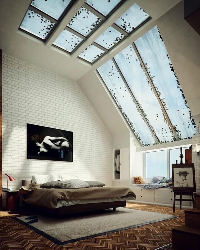 Kết hợp một số yếu tố phẳng, dốc và dọc, cửa sổ trời mang lại cho phòng ngủ màu trắng đơn giản này một cái nhìn vô cùng ấn tượng.