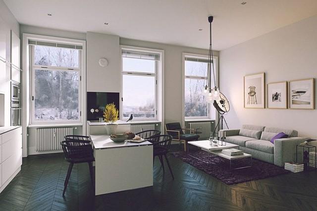 Phần lớn trong hầu hết các mẫu thiết kế, bộ bàn ăn luôn được dùng làm ranh giới phân cắt khu vực phòng khách và nhà bếp.